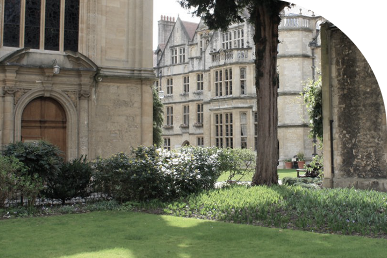 A lawn in Brasenose college, with pale brick buildings with tall windows